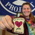 Sarah holding the 45th anniversary PB&J patch