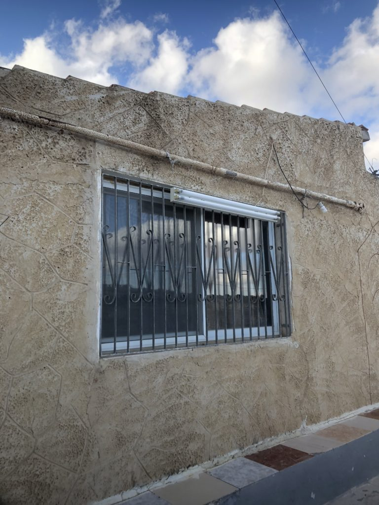 A window into Omar's house, one of the few homes in the area unoccupied by Israeli settlers.